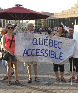 "Four women holding a banner with the words ""Quebec Accessible""."